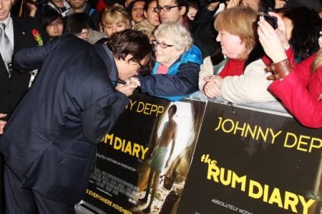 Джонни Депп и Эмбер Хард на премьере фильма The Rum Diary. Фото: Dave Hogan/Getty Images