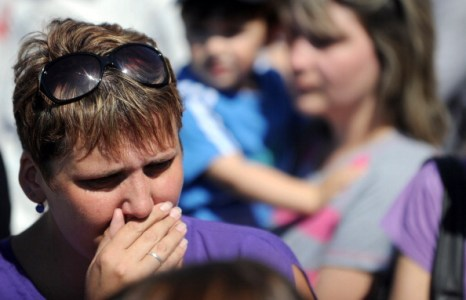 В день национального траура Россия скорбит по погибшим на затонувшем теплоходе «Булгария». Фото: NATALIA KOLESNIKOVA/AFP/Getty Images