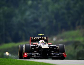 Гран при Малайзии: Виталий Петров сошёл с дистанции. Фото: Clive Mason/Getty Images