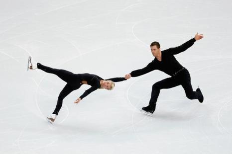 Чемпионы Канады по фигурному катанию Кирстен Мур и Дилан Москович провели 3 февраля первые тренировки в Сочи перед выступлением на зимних Олимпийских играх 2014. Фото: Robert Cianflone/Getty Images