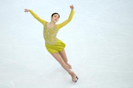 Юна Ким из Южной Кореи исполняет короткую программу 19 февраля 2014 года На Олимпиаде в Сочи. Фото: Ryan Pierse/Getty Images