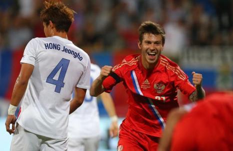 Футбольная сборная России одержала победу в товарищеском матче, встретившись в Дубае (ОАЭ) с командой из Южной Кореи 19 ноября 2013 года. Фото: MARWAN NAAMANI/AFP/Getty Images