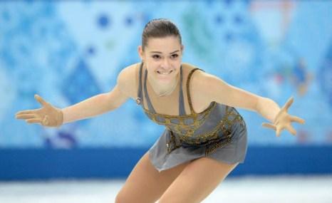 Аделина Сотникова выступила на Олимпиаде с произвольной программой, показав «золотой» результат20 февраля 2014 года. Фото: YURI KADOBNOV/AFP/Getty Images