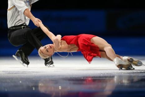 Пара Максим Траньков и Татьяна Волосожар стали первыми на Гран-при по фигурному катанию Skate America в Детройте 20 октября 2013 года, поставив также очередной мировой рекорд. Фото: GEOFF ROBINS / AFP / Getty Images