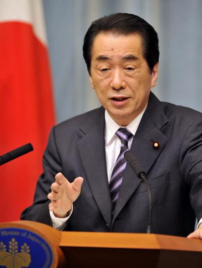 Фоторепортаж. Представитель кабинета министров Японии Нориюки Шиката от имени премьер-министра Наото Кана. Фото: Getty Images