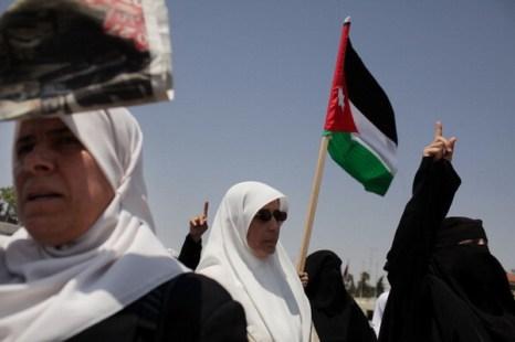 Фоторепортаж об антиправительственных протестах женщин в Иордании. Spencer Platt/Getty Images