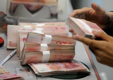 Китай пытается продвинуть юань на международный рынок. Фото: MARK RALSTON/AFP/Getty Images