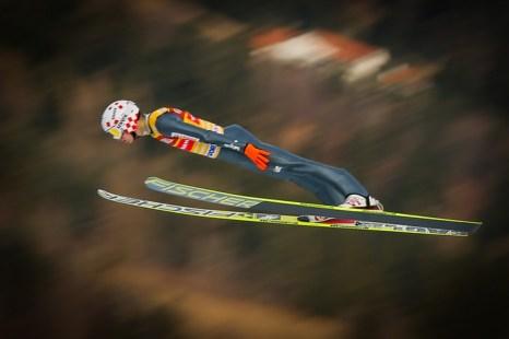 Польский лыжник Камил Стох — золотой призёр по прыжкам с большого и среднего трамплина, Олимпиада в Сочи, 15 февраля, 2014 год. Фото: Stanko Gruden/Agence Zoom/Getty Images