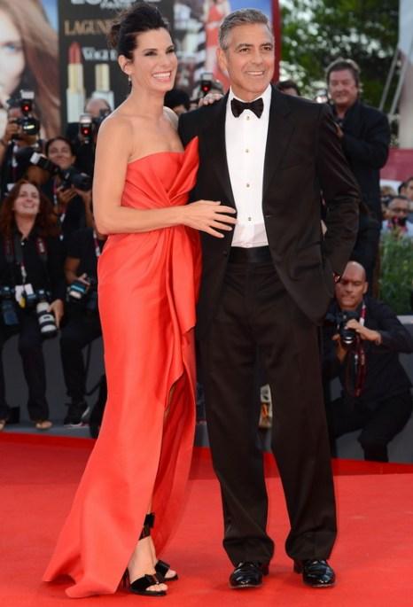 Сандра Буллок и Джордж Клуни посетили открытие юбилейного, 70-го Международного кинофестиваля в Венеции 28 августа 2013 года на острове Лидо (Италия). Фото: Ian Gavan/Getty Images