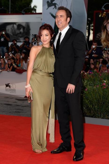 Актёр Николас Кейдж и его жена Элис Ким Кейдж прибыли на премьеру фильма «Джо» (Joe) 70-го Венецианского международного кинофестиваля 30 августа 2013 года Венеция, Италия. Фото: Pascal Le Segretain/Getty Images