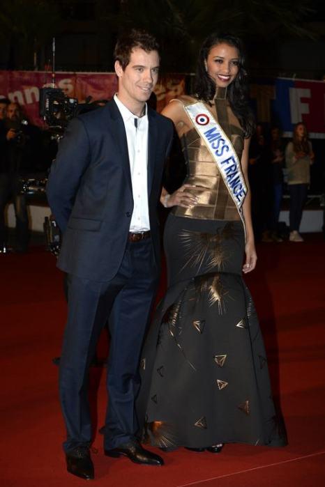 Мисс Франции 2014 Флора Кокерель и теннисист Ришар Гаске на церемонии вручения 15-й ежегодной музыкальной премии NRJ во Дворце фестивалей в Каннах (Франция) 15 декабря. Фото: Pascal Le Segretain / Getty Images