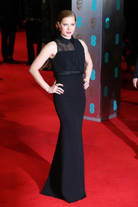 Эми Адамс прибыла в Лондон 16 февраля на церемонию вручения наград британской киноакадемии BAFTA  2014.Фото: Chris Jackson/Getty Images