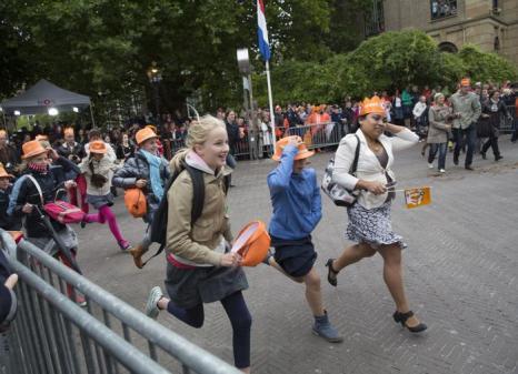 Торжественное мероприятие открытия сессии парламента в Нидерландах в День принца 16 сентября 2013 года привлекает тысячи жителей и туристов страны. Фото: Michel Porro/Getty Images