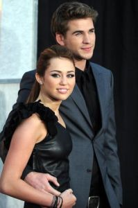 Actress and singer Miley Cyrus and actor