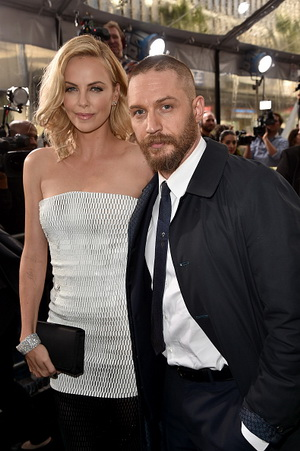 "HOLLYWOOD, CA - MAY 07:  Actors Charlize Theron (L) and Tom Hardy attend the premiere of Warner Bros. Pictures' ""Mad Max: Fury Road"" at TCL Chinese Theatre on May 7, 2015 in Hollywood, California.  (Photo by Kevin Winter/Getty Images)"