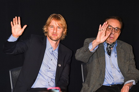 "TOKYO, JAPAN - OCTOBER 29: (L-R) Actor Owen Wilson and Director Peter Bogdanovich wave hands at the stage greeting of ""She's Funny That Way"" during the 27th Tokyo International Film Festival at Roppongi Hills on October 29, 2014 in Tokyo, Japan.  (Photo by Koki Nagahama/Getty Images)"