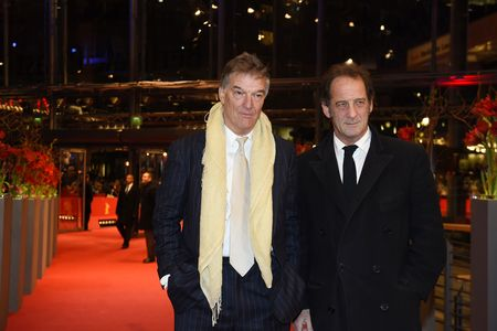 "French actor Vincent Lindon (R) and director Benoit Jacquot arrive for the screening of the film ""Journal d'une femme de chambre"" (Diary of a Chambermaid) presented in the competition of the 65th Berlin International Film Festival Berlinale in Berlin, on February 7, 2015.  AFP PHOTO / TOBIAS SCHWARZ        (Photo credit should read TOBIAS SCHWARZ/AFP/Getty Images)"