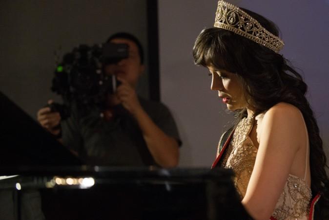 Анастасия Линь во время приёма исполнила музыкальное произведение, посвящённое жертвам репрессий в Китае. Фото: Matthew Little/Epoch Times