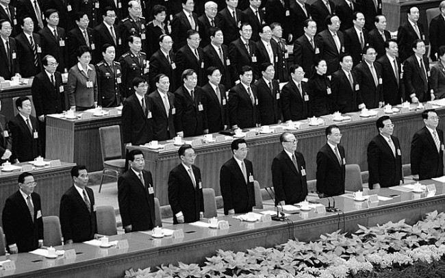 BEIJING - OCTOBER 21: (L-R: front row) Chinese leaders Luo Gan, Wu Guanzheng, Jia Qinglin, Wu Bangguo, Hu Jintao, Jiang Zemin, Wen Jiabao, Zeng Qinghong and Li Changchun attend the 17th Chinese Communist Party Congresson at the Great Hall of the People on October 21, 2007 in Beijing, China. The Communist Party wrapped up its five-yearly congress on October 21 with leadership changes and President Hu Jintao's vision for China written into its charter. (Photo by Guang Niu/Getty Images)