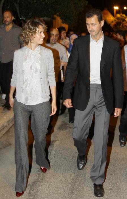 Президент Сирии Башар Асад с женой. Фото: LOUAI BESHARA/AFP/Getty Images