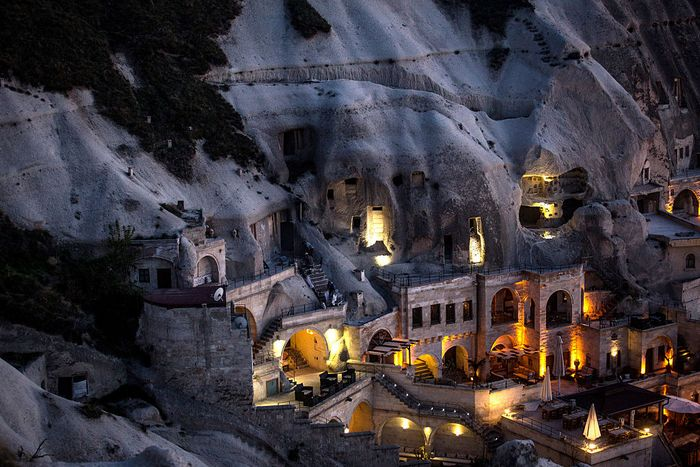 NEVSEHIR, TURKEY - APRIL 17: A cave hotel is seen at sunset in the town of Goreme on April 17, 2016 in Nevsehir, Turkey. Cappadocia, a historical region in Central Anatolia dating back to 3000 B.C is one of the most famous tourist sites in Turkey. Listed as a World Heritage Site in 1985, and known for it's unique volcanic landscape, fairy chimneys, large network of underground dwellings and some of the best hot air ballooning in the world, Cappadocia is preparing for peak tourist season to begin in the first week of May. Despite Turkey's tourism downturn, due to the recent terrorist attacks, internal instability and tension with Russia, local vendors expect tourist numbers to be stable mainly due to the unique activities on offer and unlike other tourist areas in Turkey such as Antalya, which is popular with Russian tourists, Cappadocia caters to the huge asian tourist market. (Photo by Chris McGrath/Getty Images)