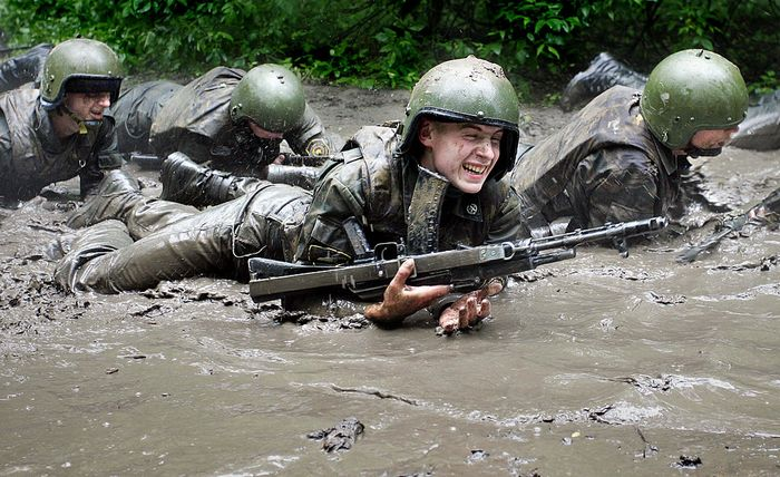 BALASHIKHA, RUSSIAN FEDERATION: 'Vityaz' anti-terror unit soldiers crawl during the examination for the maroon beret, the symbol of courage and profesionalism in Russian interior troops, near the town of Balashikha, close to Moscow, 05 June 2006. Only 6 fighters of 31 candidates got berets after the annual examination. AFP PHOTO / NATALIA KOLESNIKOVA (Photo credit should read NATALIA KOLESNIKOVA/AFP/Getty Images)
