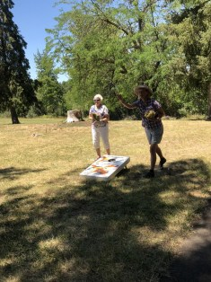 Martha Roy and Trudi Eyraud try their hand at bean bag tossing