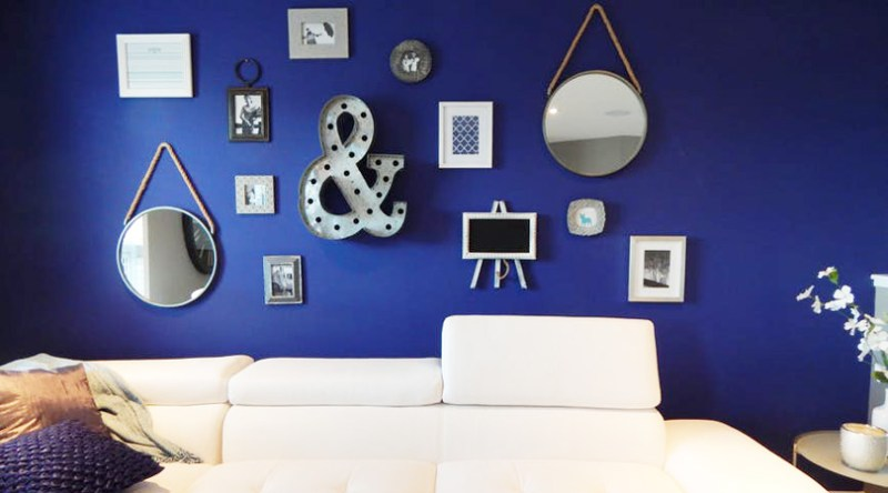 A deep blue wall with mirrors and wavy elements demonstrates a way the water element can be brought into a home - Equate Feng Shui