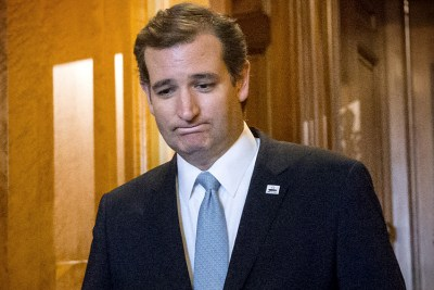 "Sen. Ted Cruz, R-Texas, emerges from the Senate Chamber on Capitol Hill in Washington, Wednesday, Sept. 25, 2013, after his overnight crusade railing against the Affordable Care Act, popularly known as ""Obamacare."" Cruz ended his marathon Senate speech opposing President Barack Obama's health care law after talking for 21 hours, 19 minutes. (AP Photo/J. Scott Applewhite)"