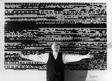 Peter Kubelka standing in front of an installation of Arnulf Rainer. (Courtesy of Mark Webber)