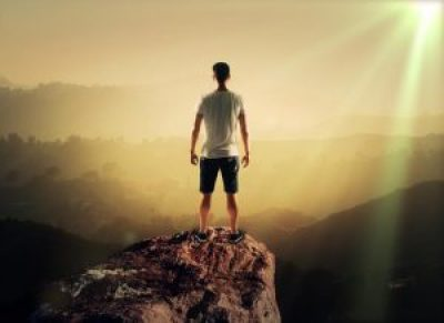 man stands on top mountain, close up