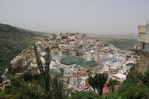 Moullay Idriss, nestled on two mountaintops. We're looking down from a high vantage point down onto the second summit in town.