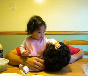 Playing with Daddy's Hair in the Kitchen