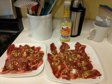 Seasoning the bistec empanizado with naranja agria (sour orange)