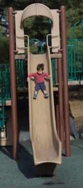 Sam slides on the big slide