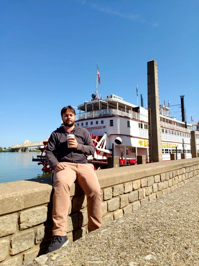 Eric Shay Howard with coffee at Belle of Louisville