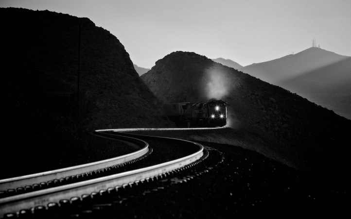 Following the best course plotted by the line's surveyors, this Union Pacific train is passing through Sloan, NV on its climb west out of the Las Vegas valley.