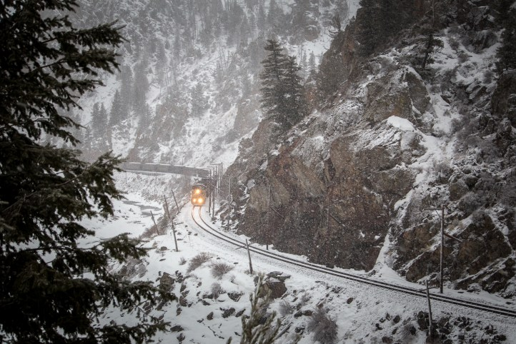 Continuing its eastward journey, the coal train moves slowly through Byers Canyon.f
