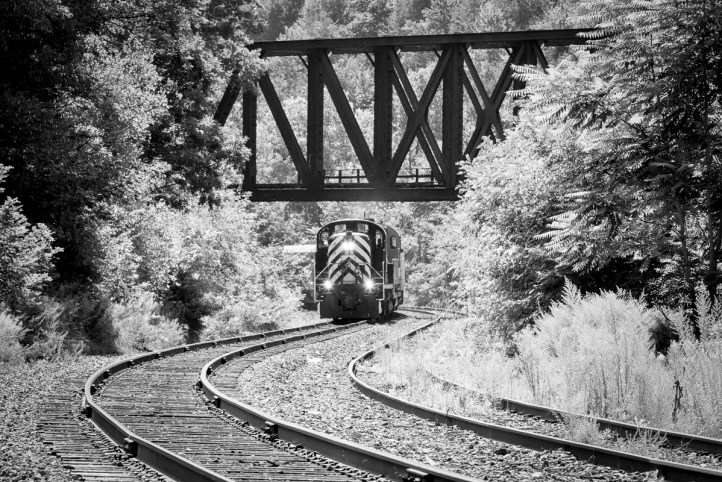 A Delaware Lackawanna excursion passes under the former CNJ bridge at Dunmore, PA.