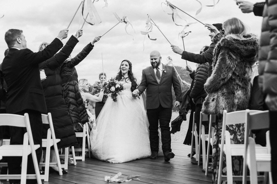 waving wands at wedding ceremony