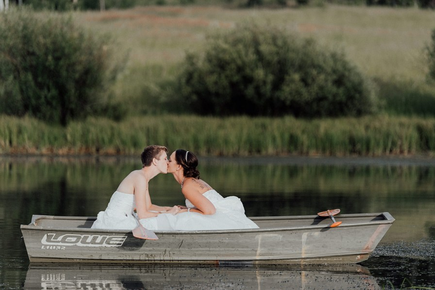 These brides wanted to go canoeing during their summer wedding at midnight ranch in Clark, Colorado