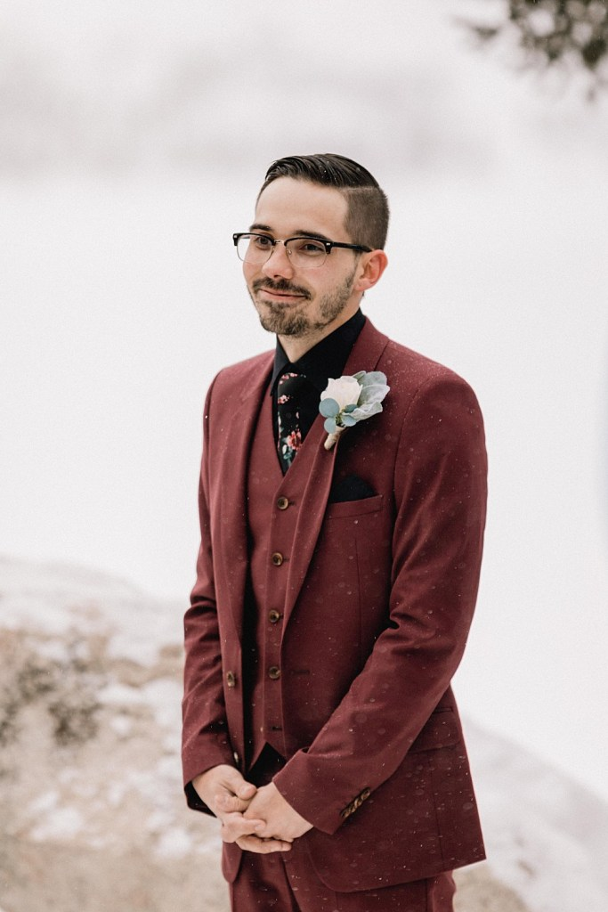 Groom sees his bride for the first time at snowy Sapphire Point elopement