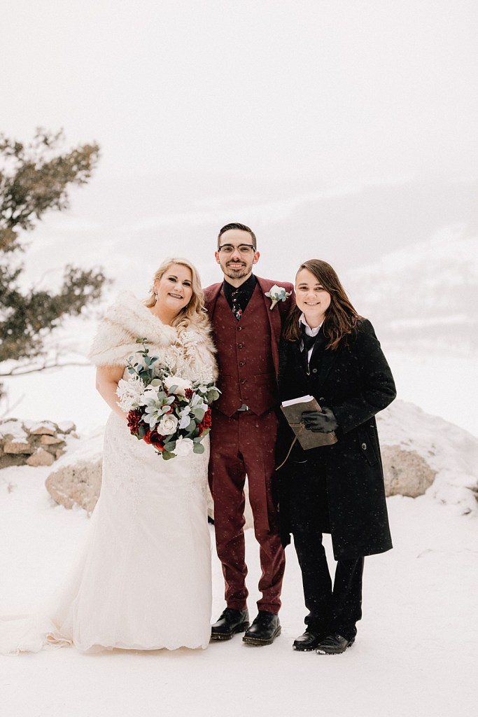 Couple with their ceremony officiant