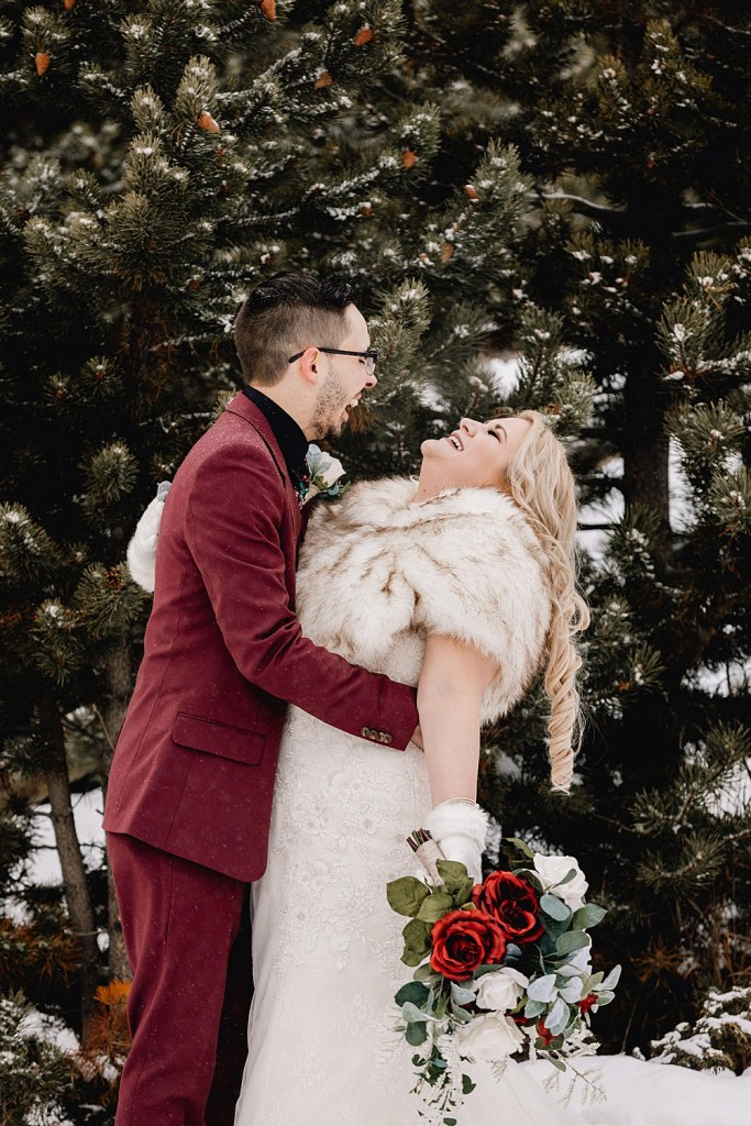 Couple laughing together at their snowy Sapphire Point elopement
