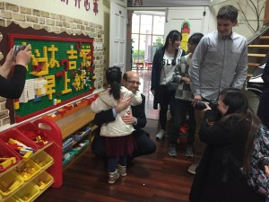 Dr. Nagle receives a warm welcome from a student at Shanghai Nanxi Preschool.