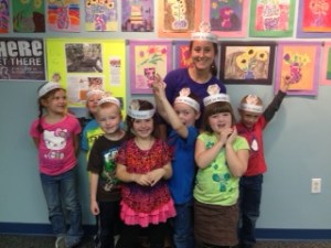 "Check out these kinders with their ""OLIVE TO READ"" crowns!"