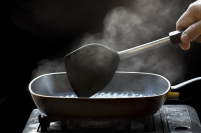 Steam On Pan In Kitchen Stock Photo