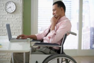 Businessman Working on His Laptop ERISA Long Term Disability Attorney in Boston