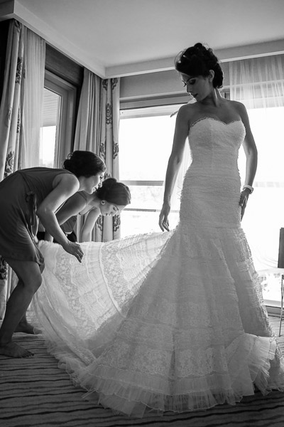 Friends helping bride