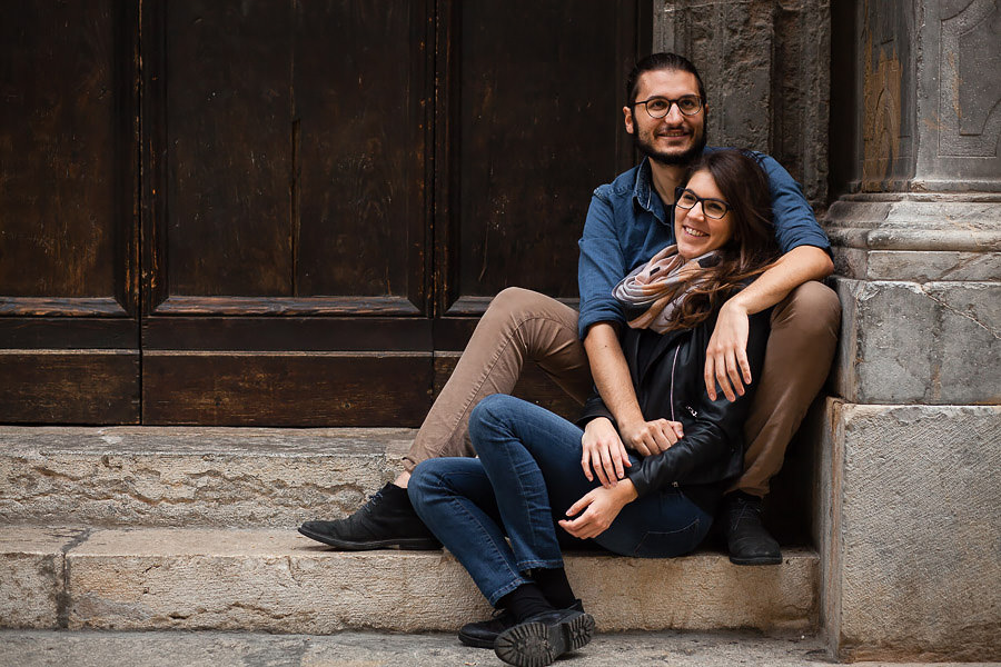 couple sitting on stairs in sicily